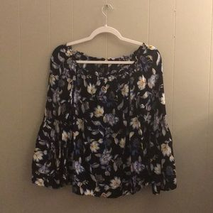 Black blouse with a blue and white floral pattern